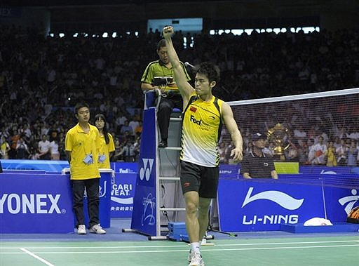 China's Lin Dan gestures to the spectators after defeating South Korea's Park Sung Hwan (not pictured)