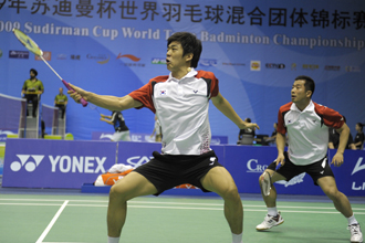 South Korea's Lee Yong Dae (left) and Jung Jae Sung (right) competes in the men's doubles preliminary match against Malaysia's Koo Kean Keat and Tan Boon Heong.