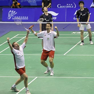 Anthony Clark (left) and Nathan Robertson (centre), ranked 19th in the world, dispatched with the No. 1 ranked Indonesians in a dominant 21-12, 21-11 victory