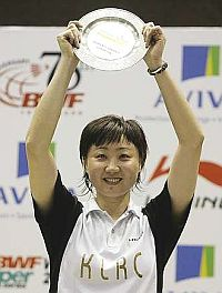 Worthy winner: Hong Kong's Zhou Mi holding the trophy after winning the women's singles final Sunday.