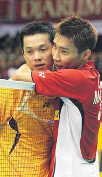 Lee Chong Wei (right) hugs Taufik Hidayat after beating him on Sunday.
