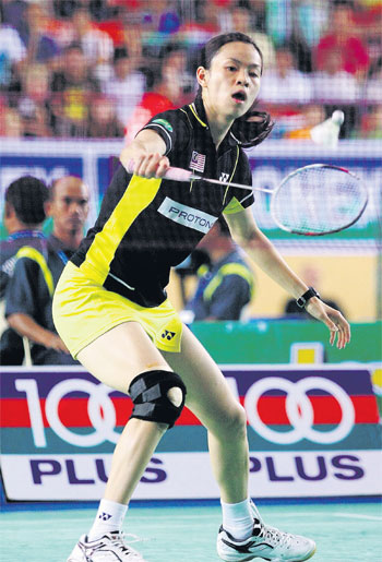 Wong Mew Choo beat Singapore's Xing Aiying 21-15, 21-17 in the Yonex-Sunrise Malaysia Open Grand Prix at the Johor City Council Indoor Stadium yesterday.