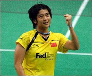 Lin Wang of China reacts after defeating Saina Nehwal by 21-16, 21-19 in the quarter-finals at the World Badminiton Championships.