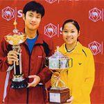 PODIUM: Boonsak Ponsana and 14-year-old Rachanok Intanon hold their silverware at the All-Thailand Championships.