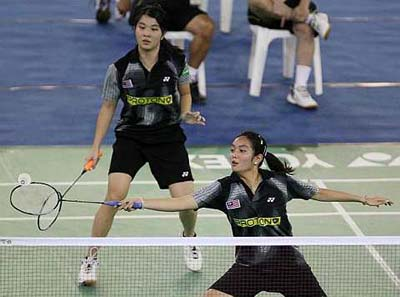 Immaterial defeat: Malaysia's Lai Pei Jing (front) and Ng Hui Ern in action against Singapore's Thng Ting Ting-Chen Jiayuan during their World Junior Championships Group Z match on Friday. Pei Jing-Hui Ern lost 19-21, 21-16, 24-26.