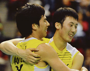 Korea's Ko Sung Hyun (left) and Yoo Yeon Seong celebrate after beating Koo Kien Keat and Tan Boon Heong in the final of the Swiss Open in Basel yesterday.