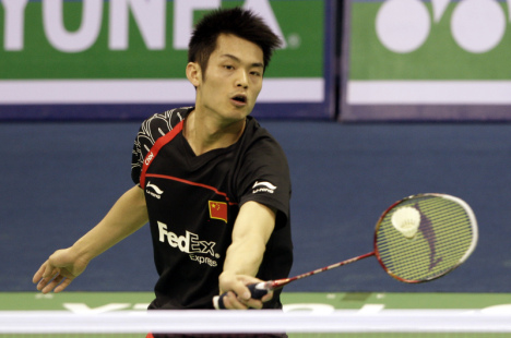 China's Lin Dan hitting a shot against Suppanyu Avihingsanon of Thailand during the Asian Championship on Wednesday.