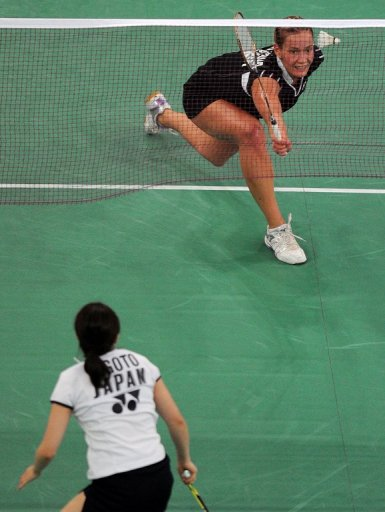 Russia's Olga Golovanova (top) seen in action against Japan's Ai Goto at the Uber Cup badminton championships