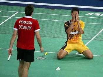 Hafiz the hero: Malaysia's third singles player Mohd Hafiz Hashim celebrates after defeating Denmark's Joachim Persson 21-12, 21-10 for the winning point in their Thomas Cup quarter-final tie at the Putra Stadium in Bukit Jalil last night.