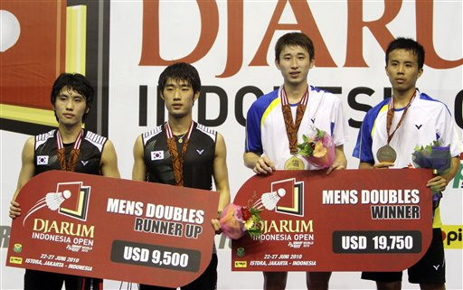 From right, Taiwanese pair Fang Chieh Min and Lee Sheng Mu, and South Korea's Cho Gun-woo, Kwon Yi-go stand on the podium after their men's doubles final at the Indonesia Open Badminton Super Series, Sunday, June 27, 2010 at Istora Senayan in Jakarta, Indonesia. The Taiwanese pair won the final match 21-16, 21-15.