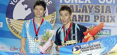 Smashing contest: Lee Chong Wei (right) and Wong Choong Hann posing with their prizes after their Malaysian Open Grand Prix Gold men's singles final yesterday. Chong Wei won 21-8, 14-21, 21-15.