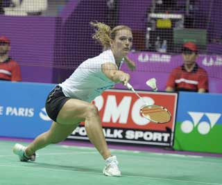 Dutch player Tine Baun hits a return to Taipei's Cheng Shao-Chieh during the Women singles quarter finals of the Badminton World Championship