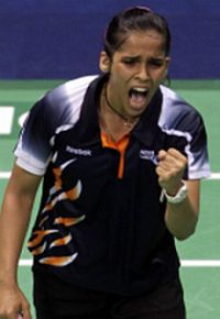 Home favourite: Saina Nehwal celebrates after defeating Wong Mew Choo in the women's singles final Thursday.