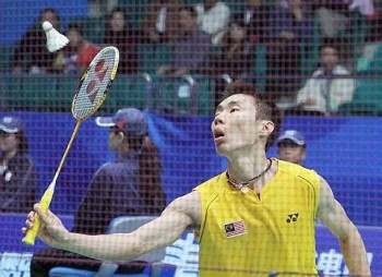 Steady progress: Lee Chong Wei in action against Hong Kong's Chan Yan Kit in the men's singles round of 16 yesterday. The Malaysian won 17-21, 21- 9, 21-6.