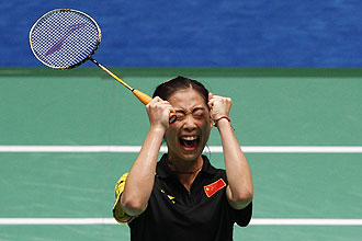 China's Wang Shixian celebrates her win over compatriot Wang Xin during the badminton women's singles final at the 16th Asian Games in Guangzhou