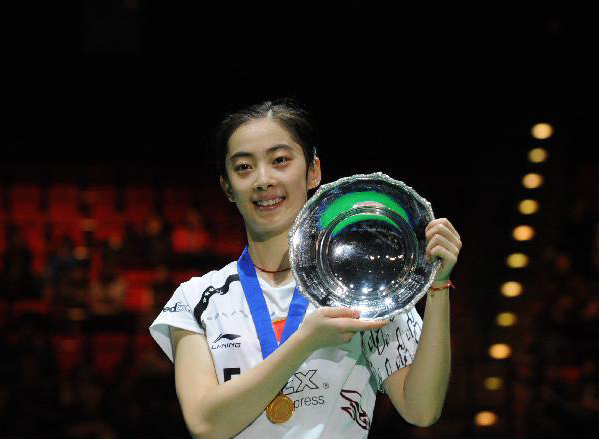 China's Wang Shixian poses with her trophy after winning the women's singles final match against Japan's Eriko Hirose in 2011's All England Open Badminton Championship at the National Indoor Arena in Birmingham, Britain, March 13, 2011. Wang won 2-0 to claim the title.