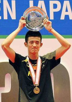 Earning respect: China's Chen Long raising his winning plate on the podium after he won the Japan Open men's singles title by beating Malaysia's Lee Chong Wei 21-8, 10-21, 21-19 in the final on Sunday.