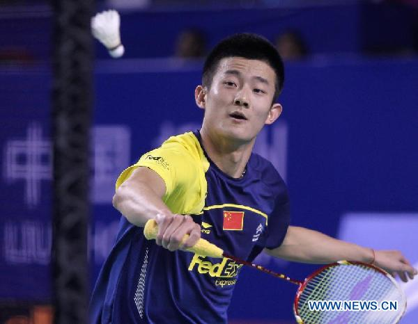 Chen Long of China competes during the semifinal of men's singles match against Lee Chong Wei of Malaysia at Li Ning BWF (Badminton World Federation) World Superseries Finals 2011 in Liuzhou, city of south China's Guangxi Zhuang Autonomous Region, Dec. 17, 2011. Chen Long won the match 2-1.