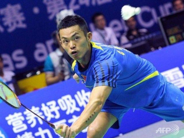 Lin Dan of China returns a shot against Rajiv Ouseph of England during their Group A match at the Thomas Cup world badminton team championships in Hubei province. Superstar Lin was made to sweat in front of an adoring home crowd but China breezed through their first group ties in the tournament.