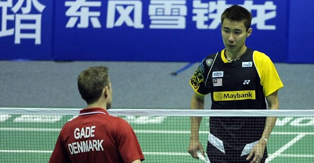 Lee Chong Wei (blue) is forced to retire against Peter Gade in Wuhan