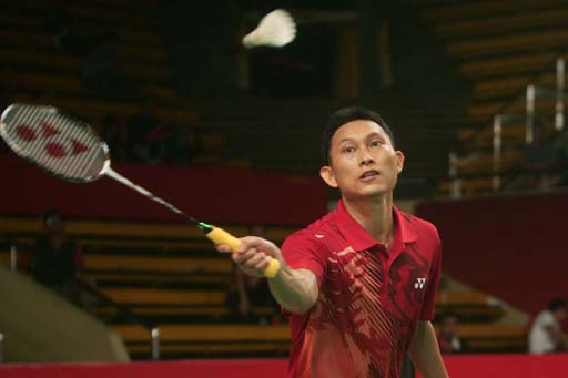 Sony Dwi Kuncoro of Indonesia returns a shot to Brice Leverdez of France during their men's singles qualifier match at the Djarum Indonesia Open on Tuesday.