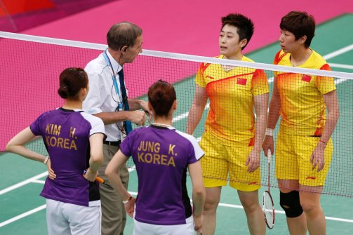 Tournament referee Torsten Berg speaks to Yu Yang and Wang Xiaoli of China and Kim Ha-na and Jung Kyung-eun of South Korean during their women's doubles group play stage Group A badminton match during the London 2012 Olympic Games at the Wembley Arena July 31, 2012.