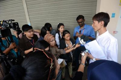 Facing the press: Lee Chong Hoon, brother of Chong Wei, speaking to reporters yesterday.