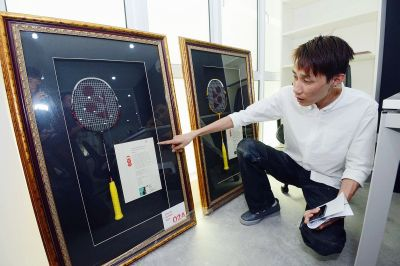 Prized possession: Chong Hoon showing the two badminton racquets that were left behind by the thieves in Chong Wei's office in Bandar Puteri Puchong.