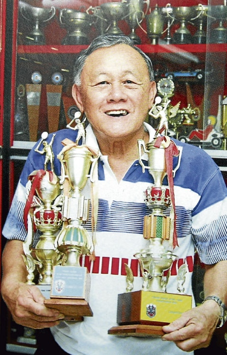 The late Datuk Eddy Choong with some of the many trophies he had won in a stellar career.