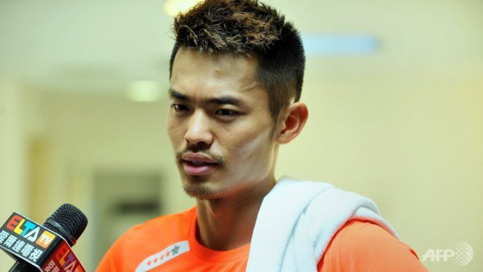 Olympic gold-medallist Lin Dan of China speaks to the Chinese media