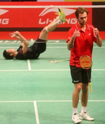 Joy and sorrow: Japan's Kenichi Tago celebrates his win over Denmark's Jan O Jorgensen Tuesday.