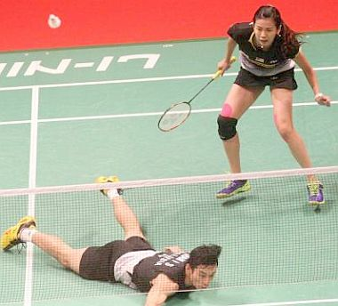 Floored: Chan Peng Soon (left) and Goh Liu Ying fail to return a shot to Germany's Micheal Fuchs and Birgit Michels during their Sudirman Cup match on Tuesday.