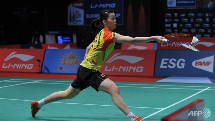 China's Li Xuerui hits a return against Indonesia's Lindaweni Fanetri