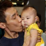 Lee Chong Wei kisses his son Kingston at the KLIA on his return from Guangzhou.