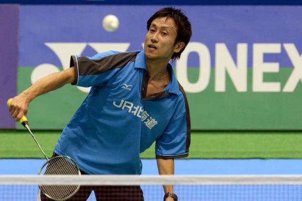 Jun Takemura returning a shot to Hu Yun of Hong Kong, as he went on to win 21-18, 21-17.