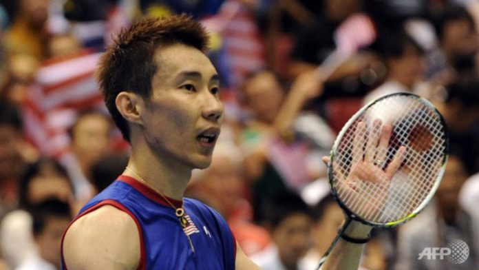Top-seeded Lee Chong Wei acknowledges the cheers after his victory over Kenichi Tago in the men's singles final match at the Japan Open. Lee won 23-21, 21-17.