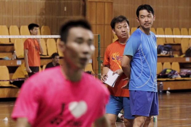 Coaches Rashid Sidek (right) and Tey Seu Bock keeping an eye on Lee Chong Wei and other players at the Juara Stadium.