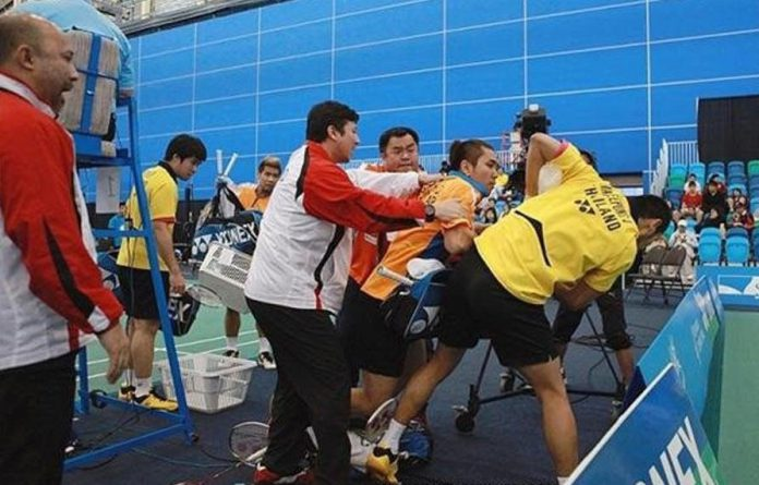 Coaches desperately try to break up the remarkable brawl between the two badminton players during the doubles final of the Canada Open in July