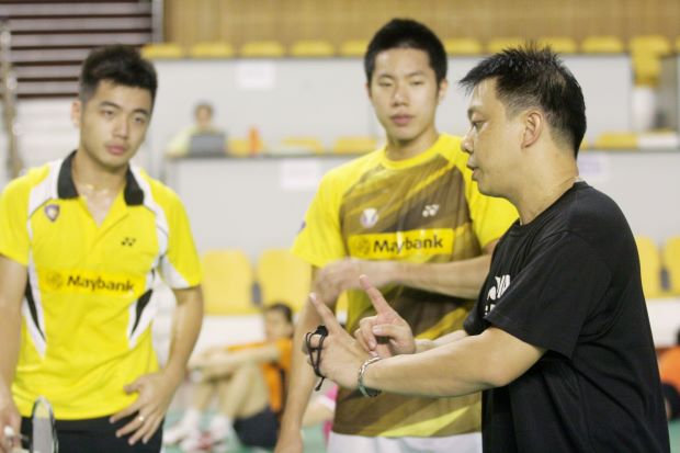 Coach Paulus Firman (right) giving instructions to Tan Wee Kiong (left) and Goh V Shem in a file photo. Paulus will be returning home to Indonesia because of family problems.
