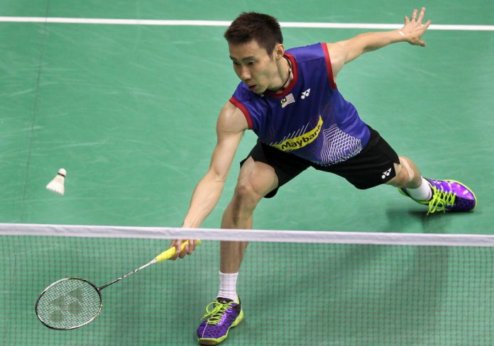 Lee Chong-wei reaches for a return during his opening match against India's Kidambi Srikanth at the Hong Kong Open.