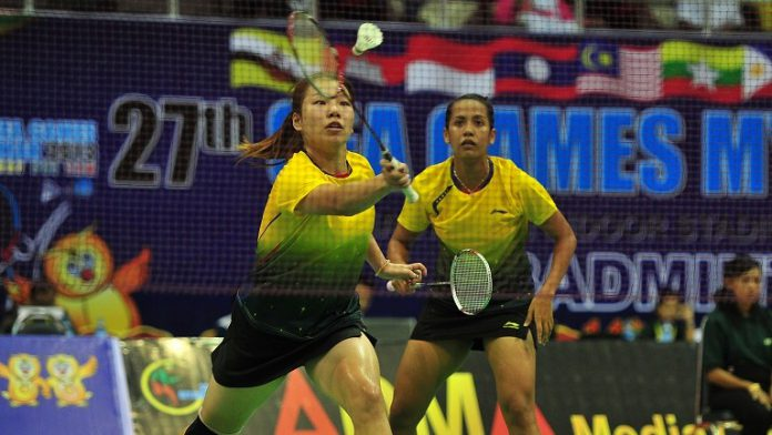 Yao Lei and Shinta Mulia Sari in action during the badminton women's doubles quarter final round at the 27th SEA Games on December 12. They beat Indonesia's Imawan Gebby Ristiyano and Nuraidah Tiara Rosalia 2 - 1.