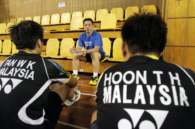 Doubles coach Paulus Firman (center) who is going back to Indonesia on Wednesday is happy that his charges Tan Wee Kiong-Hoon Thien How have finally won a title, the Macau Open, last week.