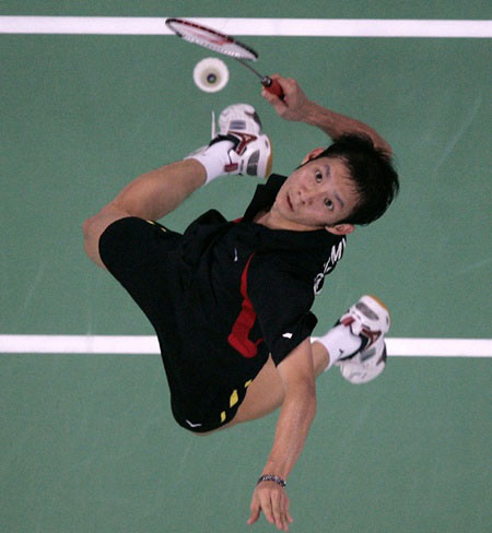 Lift off: Vietnamese badminton ace Nguyen Tien Minh rises to execute a mash. The 30-year-old player desperately seeks his first golden medal at the Southeast Asian Games.