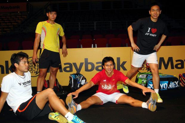 World champion men's doubles pair, Mohd Ahsan (2nd right) and Hendra Setiawan (right) warm down after a training session for the Malaysian Open badminton championship beginning on Wednesday at Bukit Jalil.