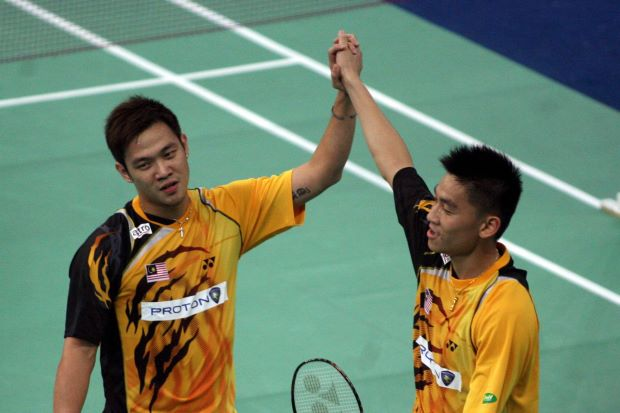 Happier times: The pairing of Koo Kean Keat-Tan Boon Heong, seen here at the 2010 Thomas Cup Finals in Kuala Lumpur, will finally come to an end when the Badminton Association of Malaysia decide to either split or drop them from the national team after seven years due to poor form in the past few years.