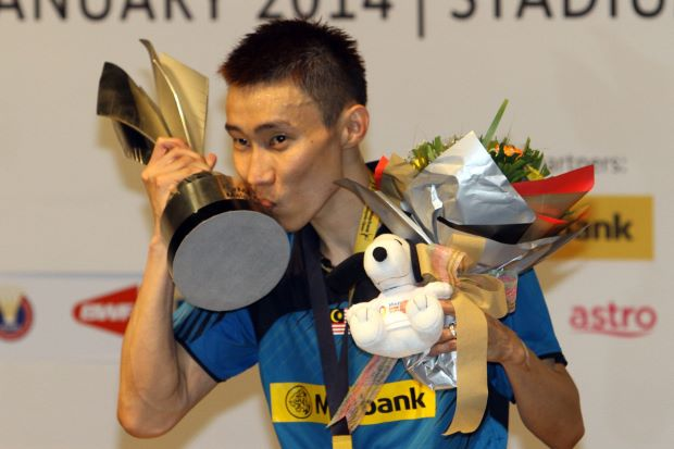 Undisputed. National and world No.1 badminton player Lee Chong Wei kisses the Malaysian Open trophy after securing his record 10th home title on Sunday. he beat Indonesian Tommy Sugiarto in straight sets in the final.