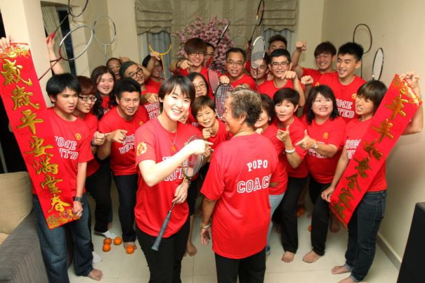 Vivian Hoo (centre) with her grandmother, 'coach' Lim Ah How, and the rest of the her family members on the eve of Chinese New Year. They are all wearing football jerseys custom-made by her uncle for the 'Home United' team.