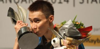 Lee Chong Wei of Malaysia kisses the trophy on the podium after winning the men's singles final match against Tommy Sugiarto of Indonesia during their Malaysia Open Badminton Superseries in Kuala Lumpur. Lee won 21-19, 21-9.