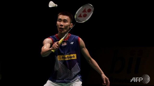 Malaysia's Lee Chong Wei returns a shot against China's Pengyu Du during their men's single quarter-final match at the Malaysia Open Badminton Superseries in Kuala Lumpur on January 17, 2014.