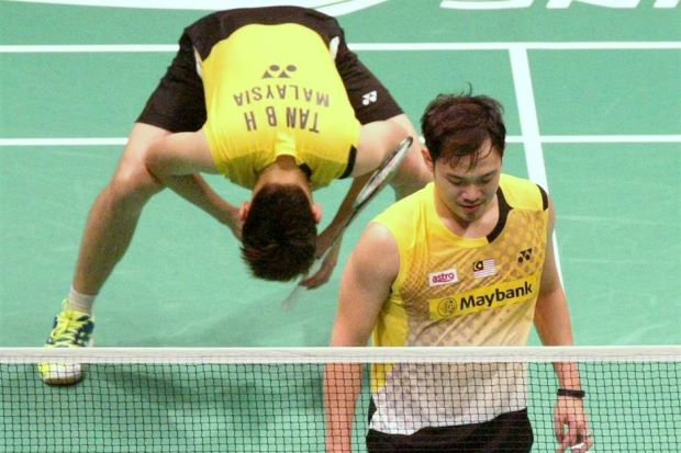 Koo Kien Keat (front) and doubles partner Tan Boon Heong seen here in a Filepic after they lost a match in the Sudirman mixed team championship last year.